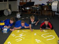 Making a banner for a football game.