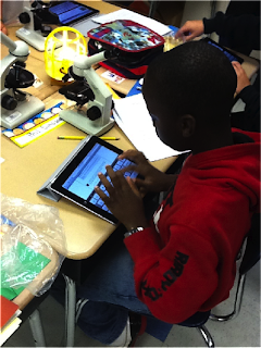 Student using an iPad tablet