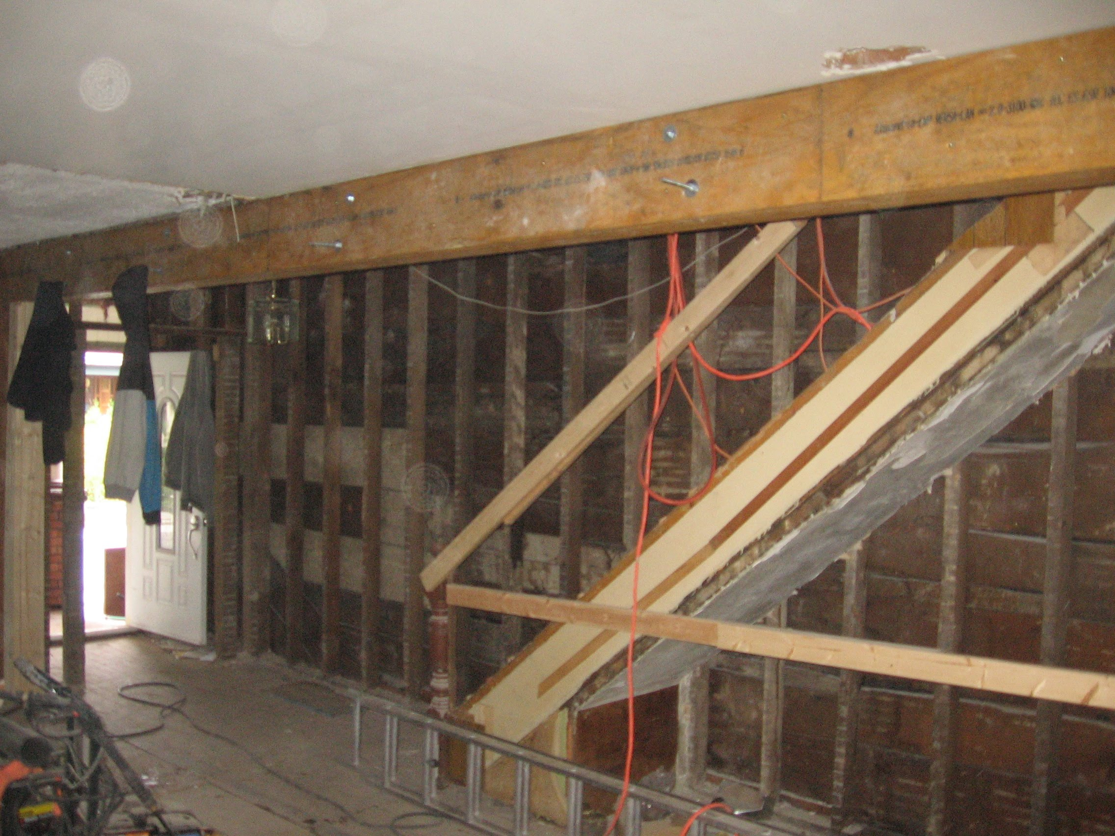Architalcan design inc for Can a load bearing wall be removed