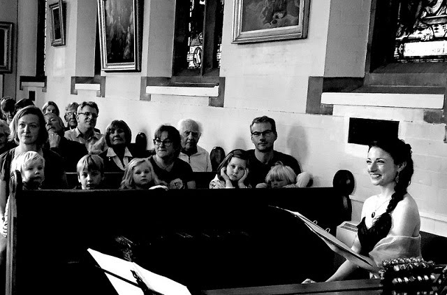 Rapt Children at Family Concert