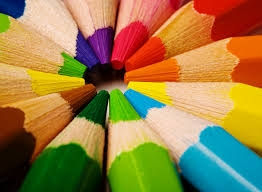 Photo of coloring pencils arranged in a rainbow layout