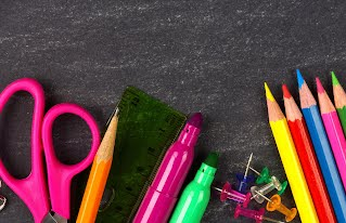Photo of classroom essentials, such as scissors, markers and a ruler