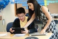 Teacher showing student information on an IPAD