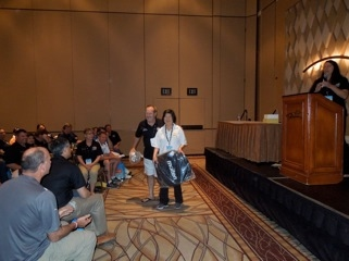 Elaina Lima receiving an award at AYSO Section conference