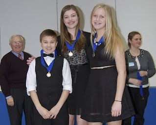 Left to right: Charles Chadbourn (Professor of Strategy at Naval War College, Washington D.C. and competition judge) Pleasant Valley Middle School students, Donovan Benko, Lilly Perrin, and Lauren Blechschmidt, and Hannah Tofte (Washington State History Office Judge)
