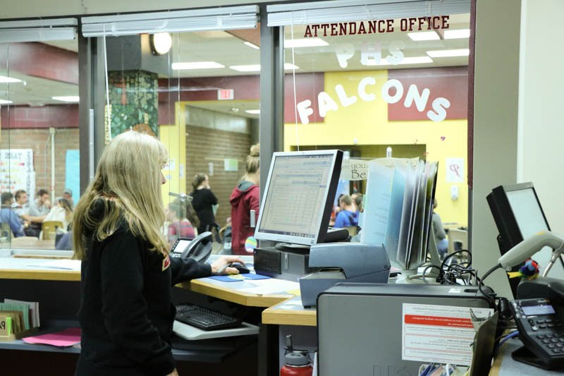 PHS employee working in the attendance office