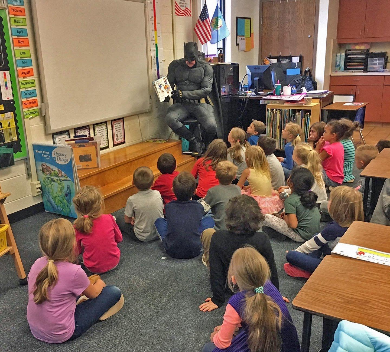Batman reads to Ms. Lutke's 1st Graders