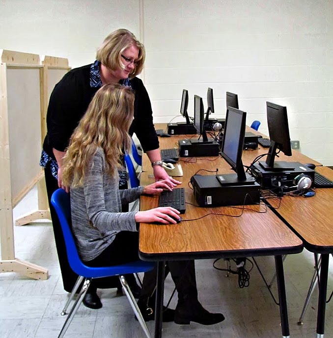 Sarah Rowe Testing Center Manager Administrator Assists A Substitute Teacher Interested In Obtaining Her Certification Credentials