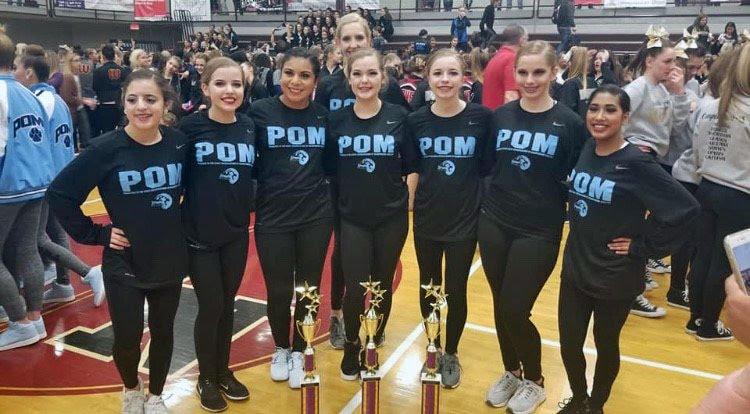 Pom with trophies
