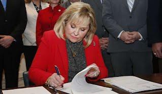 Fallin signs teacher pay raises into law