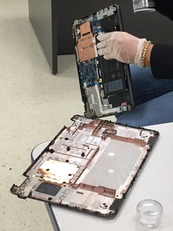 Andrea Hernandez repairs a Chromebook