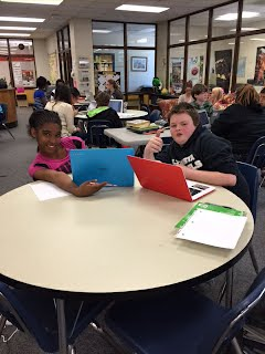 Middle School Students Using Chromebooks in the Library