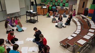 Third grade class working in recorder groups.