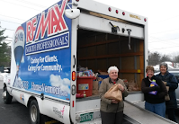 RE/MAX truck being filled with food donations