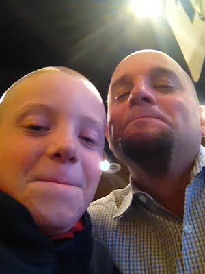 My son and I after shaving our heads for Wish Week 2014.