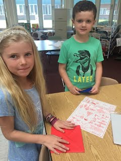 Students collaborating to create origami