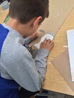 students using various media to create works of art