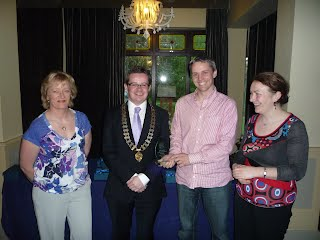 Martin Geary receiving award on behalf of Southern Gaels nursery and under 8s for best youth entry in 2011 St. Patricks day parade
