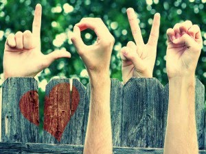 image of L O V E spelled with fingers