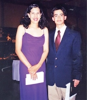 "The first scholarship recipients Hayluri ""Luly"" Beckles and Raul Mosquera at Spanish Nite in 2000."
