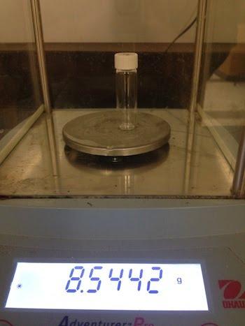 Post-weigh empty vial.