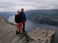 Mrs. Fiserova with her husband in Norway, standing over Preikestolen and Lysefjord.