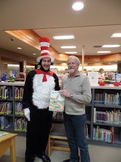 Mayor Larson and the Cat in the Hat visit patrons of the library.