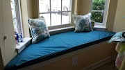 Fitted Blue Bay Window Cushion with pillows