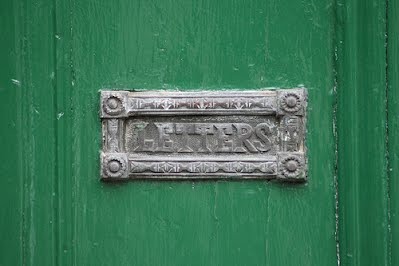 photo letter drop slot on green door