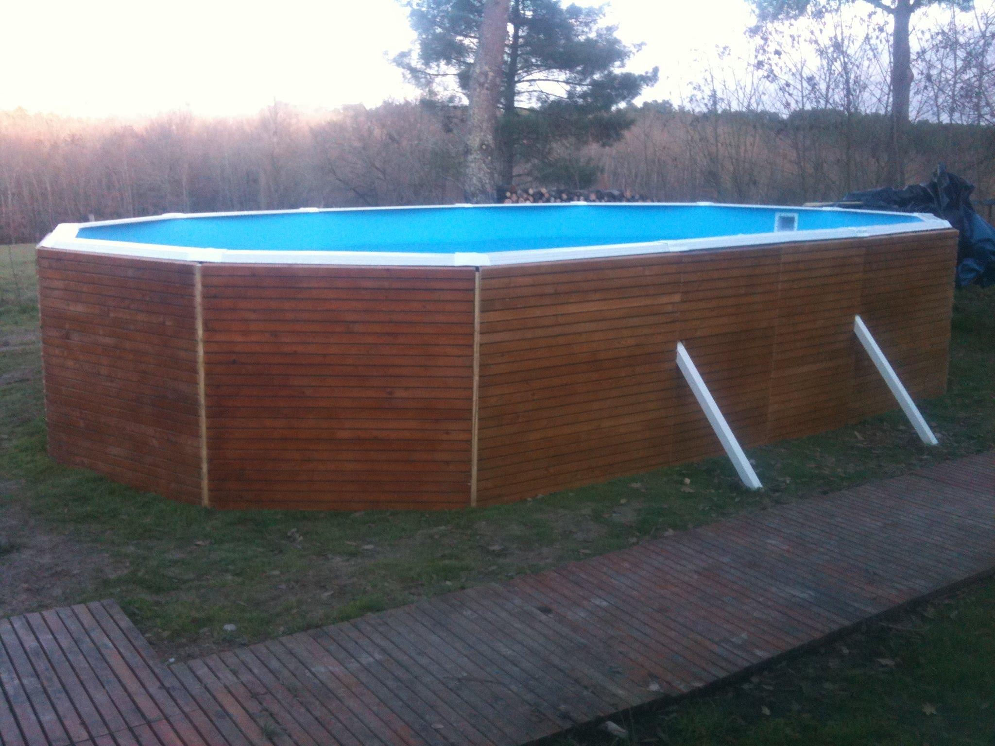 Habillage bois piscine tubulaire for Enterrer piscine tubulaire