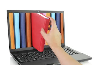 laptop with colored books