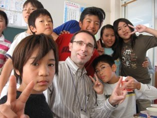 Mr. Clayton with students in Japan