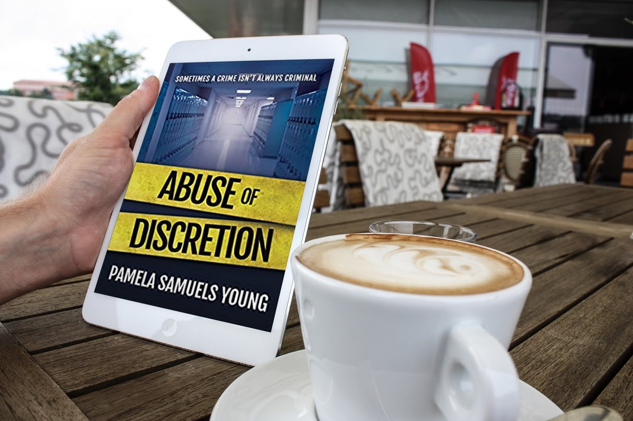 photo Abuse of Discretion by Pamela Samuels Young being held on tablet by coffee_zps2kwgk2kr.jpg