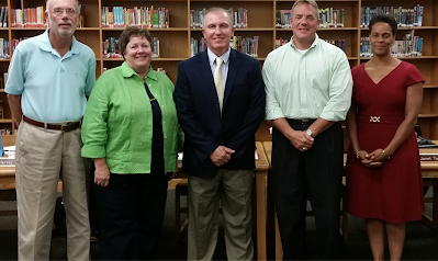 Picture of School Board Members and Dr. Comer