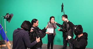Students recording a scene for a short film.