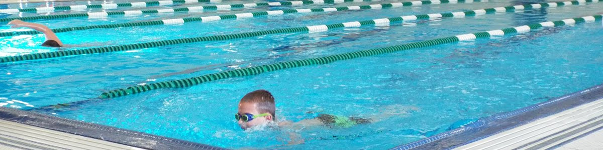 boy with goggles swimming
