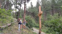 lowering the cross with ropes