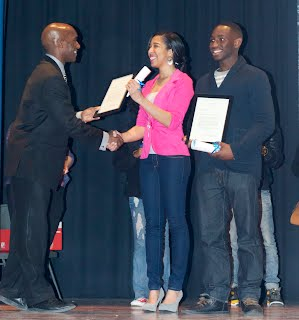 Nikki Barlow an Tobi Oke receive their IB diplomas from Principal Coleman