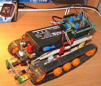 https://sites.google.com/a/project-ss.ru/anwi-sch/_/rsrc/1284891996893/robotostroenie/robot-na-gusenicnom-sassi/Robot03.jpg?height=343&width=400