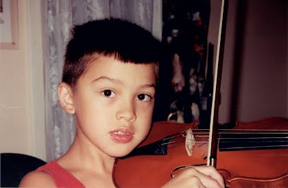 Robert began playing violin little-by-little after age 5, here he is about age 8.