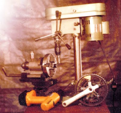 Color Photo of Self-Reproducing Milling Machine, First Attempt, by Doug Goncz, Posed with Bicycle Cranks, which in theory could be made by this machine, and power screwdriver, used to build and operate the machine