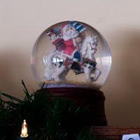 Vintage Santa on Horse Snow Globe