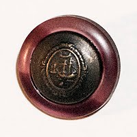 Antique Celluloid with metal insignia Button