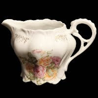 Antique Porcelain cream pitcher with flowers