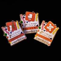 Vintage metal Rainbow Foods Olympic Pins