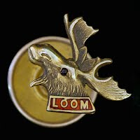 Antique Moose Lapel Pin, ruby eye, LOOM