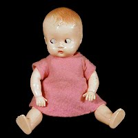 Vintage Celluiod Doll with moveable arms, open and shut eyes