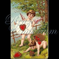 Antique Valentine Postcard with hearts and cupids