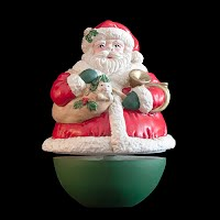 Vintage Christmas Roly Poly Santa Music box, plays Jingle Bells and turns