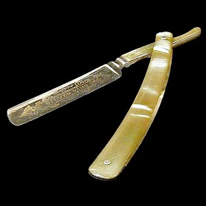 Antique Straight Edge Razor, engraved in gold on blade,bakelite handle, 1908-1921 Wilbert Cutlery Chicago